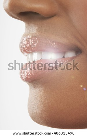 Woman smiling with very white sparkly teeth