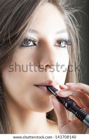 woman smokes arab pipe