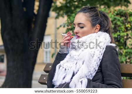https://thumb1.shutterstock.com/display_pic_with_logo/4397689/550059223/stock-photo-woman-smoking-a-cigarette-smoking-issues-550059223.jpg