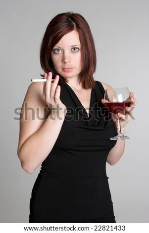 Woman Smoking and Drinking Wine - stock photo