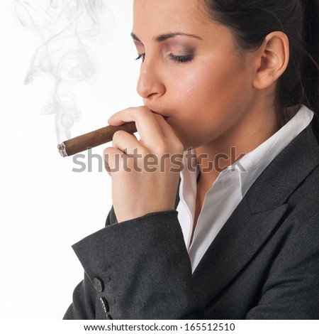Woman smoking cigar. Studio fashion photo on white background. - stock photo