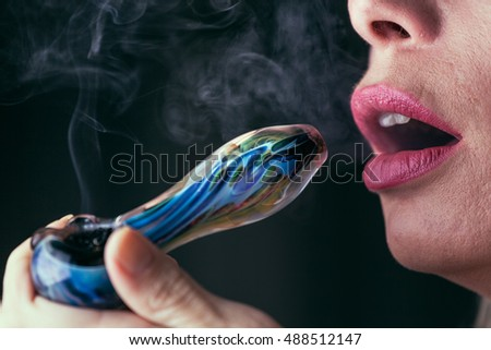 Woman Smoking Medical Marijuana Close Up. Selective focus.