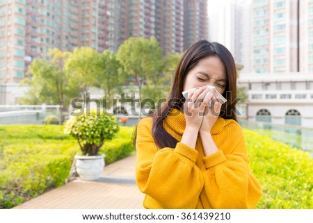 Woman sneezing - stock photo
