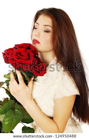 Woman sniffing bouquet of roses covered his eyes - stock photo