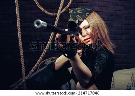 Woman sniper - stock photo