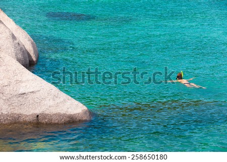 Woman snorkeling in the ocean - stock photo