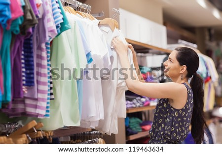 Woman sorting clothes at a boutique