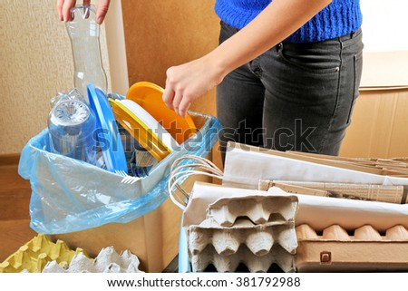 Woman sorting different waste, indoors - stock photo