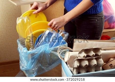 Woman sorting waste, close-up - stock photo
