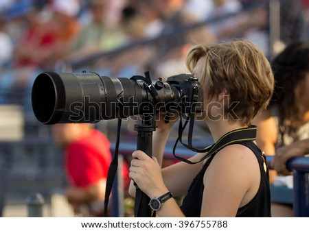 woman sports photographer