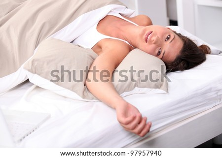 Woman sprawled in bed