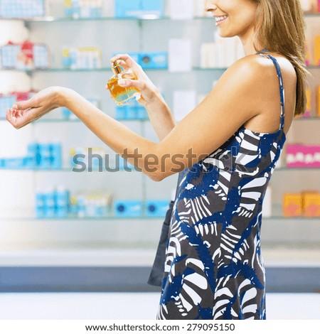 woman spraying perfume - stock photo