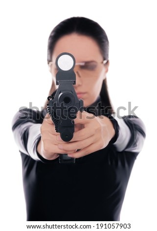 Woman Spy Aiming Gun - Woman in a black leather suit pointing a gun at the camera