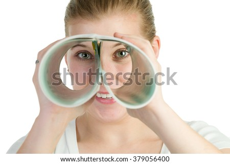 Woman spying through a double roll of paper. - stock photo