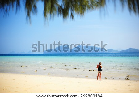 Woman Stand Alone on the Beach