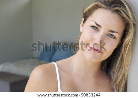 Woman standing at bedroom door, portrait