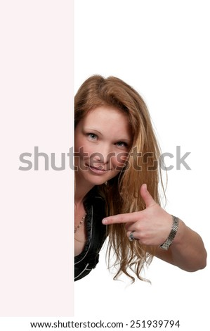 Woman standing behind a display board or wall - stock photo