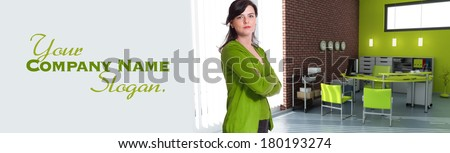 Woman standing in an office in green shades  - stock photo