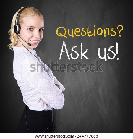 "woman standing in front of a chalkboard with the message ""Questions? Ask us!"" - stock photo"