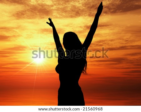 Woman standing in front of bright sunset