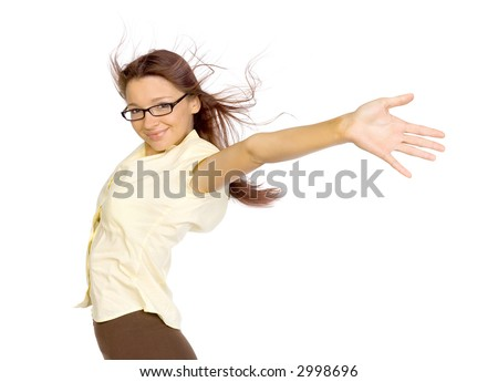 Woman standing in the strong wind. Her arms stretched up. She's smiling. Isolated on white in studio. - stock photo
