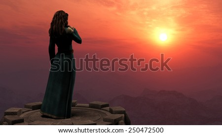 Woman standing on a tower in mountains at sunset - stock photo