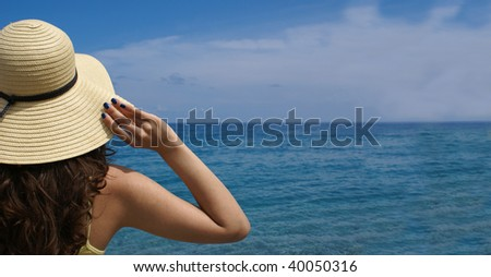 Woman standing on shoreline at the beautiful beach . Lots of copy space.