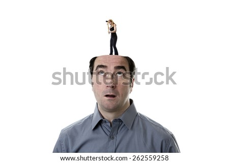 woman standing on top of a man head swinging a sledgehammer not very happy with him - stock photo