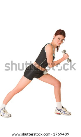 Woman standing side ways, working out with weights.