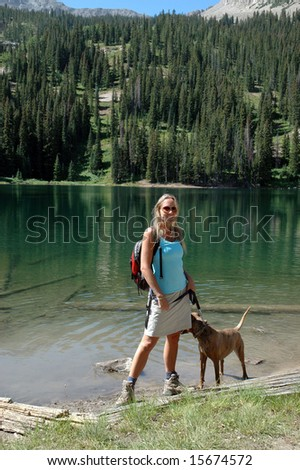 Woman standing with dog - stock photo