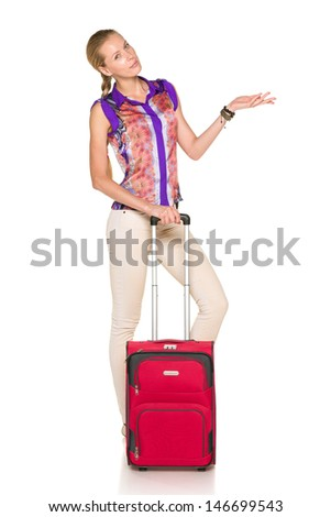 Woman standing with red suitcase and showing blank copy space, against white background