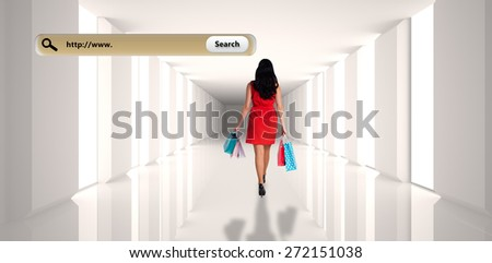 Woman standing with shopping bags against digitally generated room - stock photo