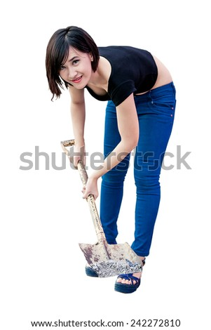 woman stands with spade over white . isolated