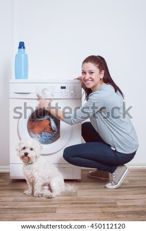 Woman Starting Washing Machine - stock photo