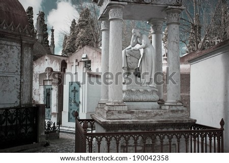 Woman statue in an old european cemetery alley. Infrared. - stock photo