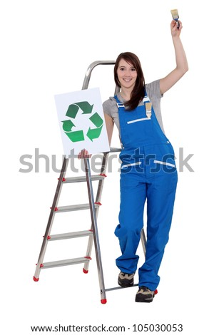Woman stood with recycle logo and paint brush