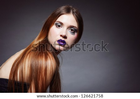 woman straight long hair make-up posing in studio dark background