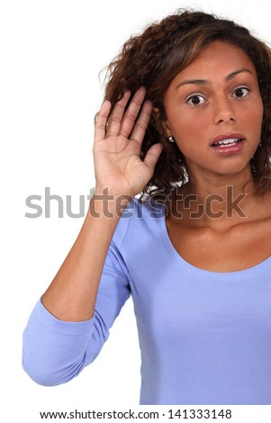 Woman straining to hear - stock photo