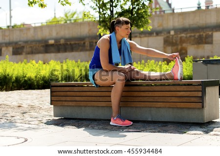 Woman stretching after, before jogging. - stock photo