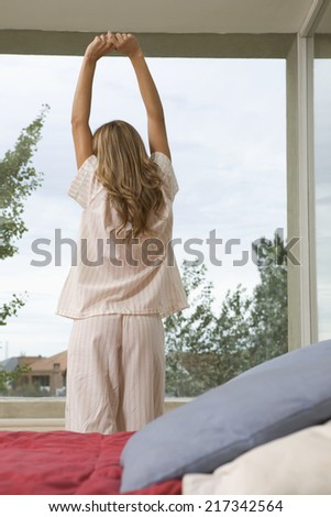 Woman stretching in the morning - stock photo