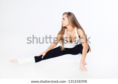 Woman stretching muscles - stock photo