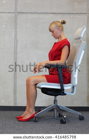 woman stretching neck  - reducing stress - stock photo