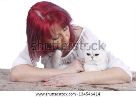 Woman strokes a white persian cat