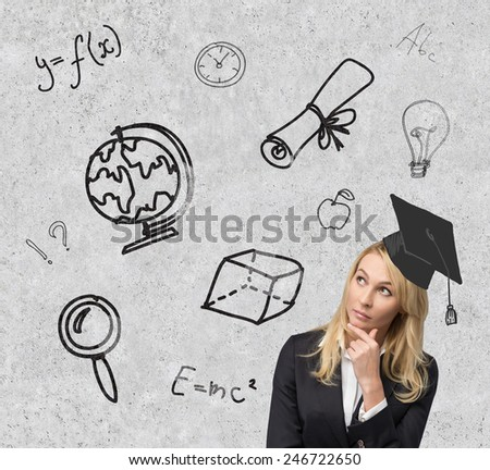 woman student  looking on education symbol on wall - stock photo