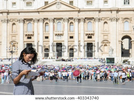 woman studying a city map at St. Peter's Basilica in Vatican