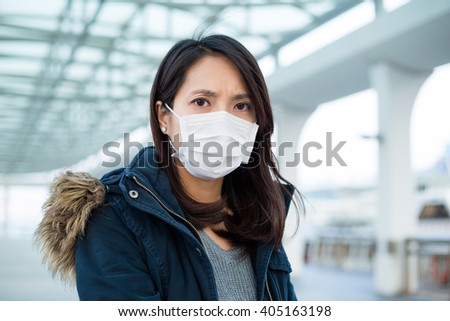 Woman suffer from illness and wearing face mask - stock photo