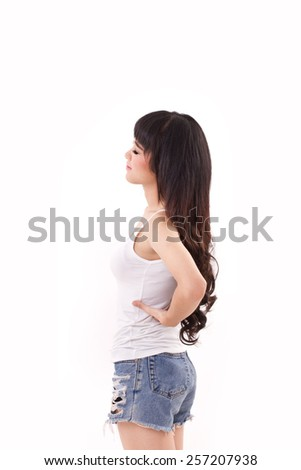 woman suffering from back pain or injury - stock photo