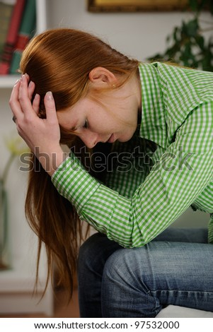 woman suffering from depression order headache - stock photo