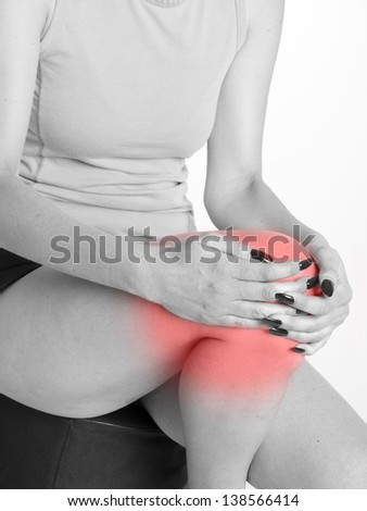 woman suffering from knee joint pains isolated on white background
