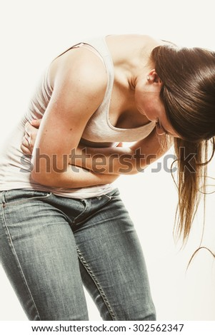 Woman suffering from stomachache pain. Girl having period bellyache. Health.